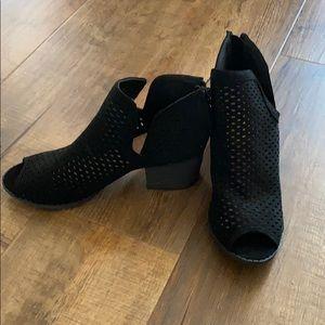 Black booties. Bella Marie